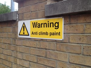 "We had no idea what this sign meant. The bricks didn't seem any different with the ""anti-climb paint"" on them. We even tested it. Yes. we tested it. Something we would have not done with kids in tow."